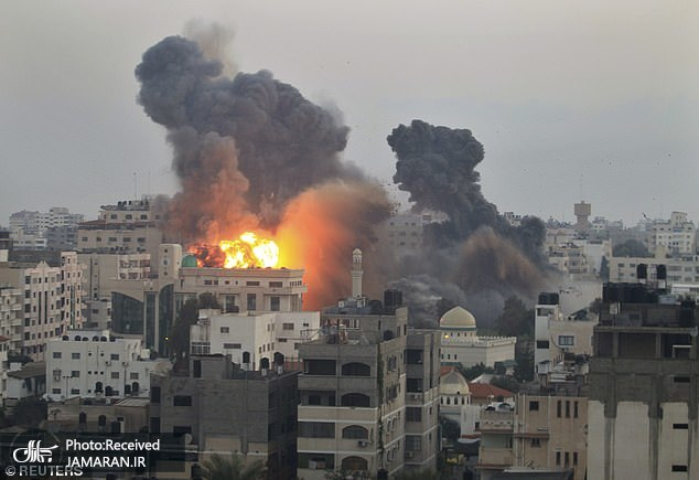 43742045-9643453-Smoke_from_explosions_are_seen_over_Gaza_City_following_Israeli_-a-129_1622645996427