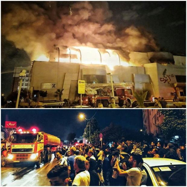 آتش سوزی گسترده در یک مجتمع تجاری در تهران + عکس و فیلم