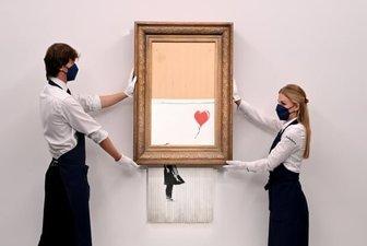 فروش 18.5 میلیون پوندی تابلو نقاشی «دخترک و بادکنک بنکسی»