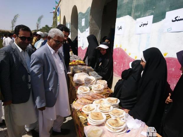 جشنواره غذاهای بومی در روستای احمد آباد ایرانشهر برگزار شد