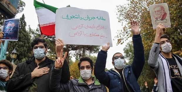 تجمع دانشجویان برای اعتراض به سفر دبیرکل آژانس اتمی به ایران + عکس