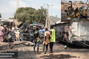 عکس/ 40 کشته و زخمی بر اثر انفجار در حین سرقت بنزین از تانکر واژگون شده
